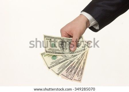Hand handing over money isolated on white background - stock photo