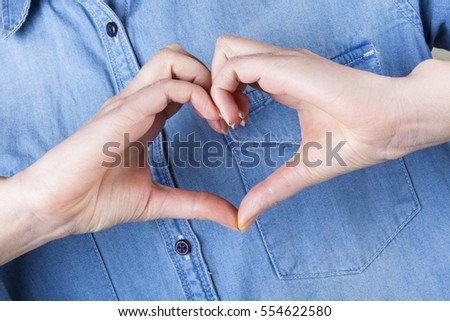 hand heart gesture love concept blue jeans
