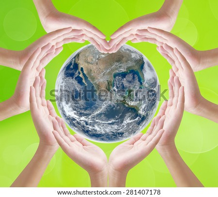 Hand heart shape on earth background , concept design  , Elements of image are furnished by NASA