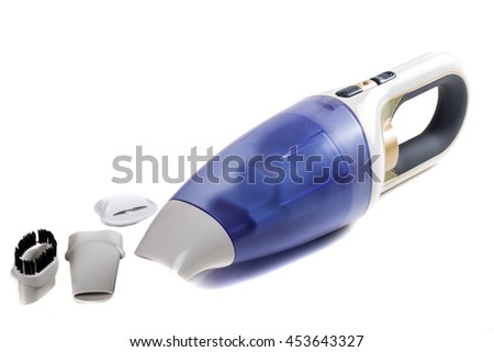 Hand-held vacuum cleaner with accessories isolated on a white background