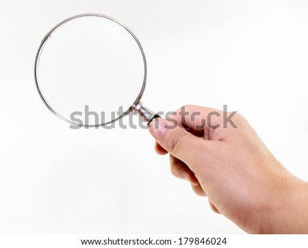 Hand hold a magnifying glass - stock photo