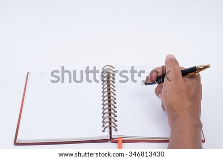 Hand hold a pen write. - stock photo