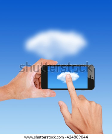 Hand Hold and Touch on Mobile Cloud computing Network - stock photo