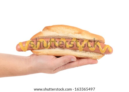 Hand hold big hotdog. Isolated on a white background.