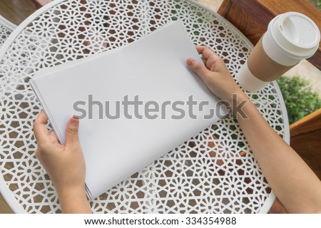 Hand hold Blank Newspaper with empty space mock up - stock photo