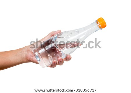 Hand hold bottle of drinking water isolated on white background.