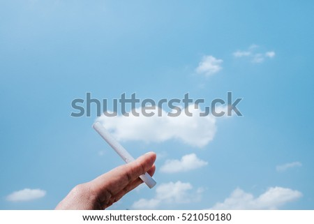 Hand Hold Cigarette with Smoke as the Cloud Idea Inspiration for World Campaign