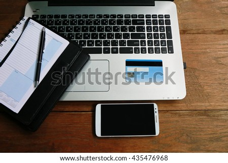 hand hold credit card on laptop - stock photo