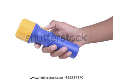 Hand hold flashlight on white background - stock photo