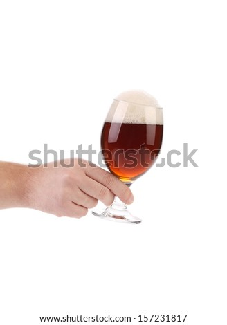 Hand hold  glass of brown beer.  Isolated on a white background