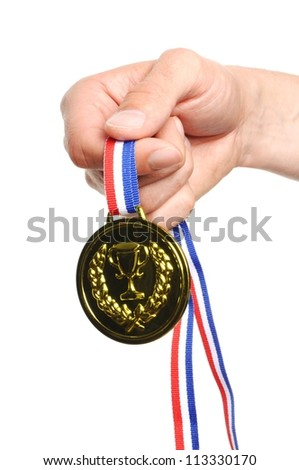 hand hold gold medal with ribbon on white background - stock photo
