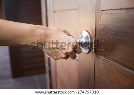 hand hold handle of wood door  - stock photo