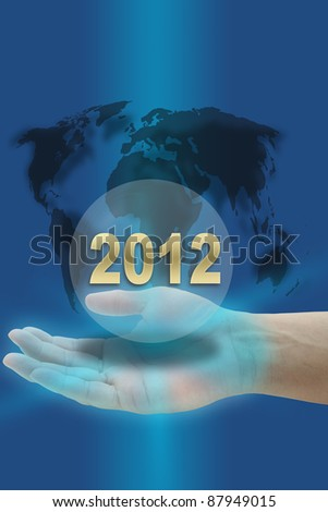 hand hold Happy New Year 2012 with world map - stock photo