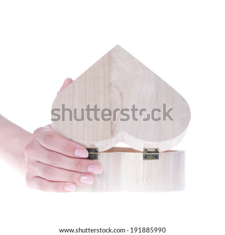 Hand hold heart shaped wooden gift box isolated on white - stock photo