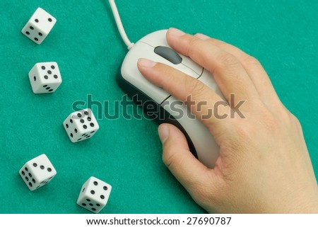 Hand Hold on Mouse by Dices - stock photo