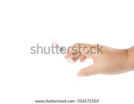 hand hold plastic syringe on white background
