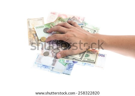 Hand hold several bank notes of american singapore indonesian thai korean and coins isolate on white background