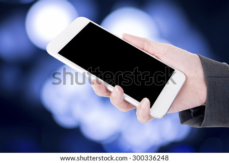hand hold smart phone over beautiful background