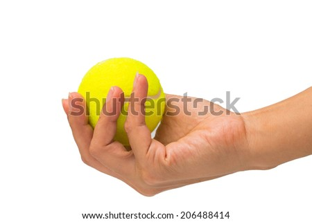 Hand hold tennis ball on white background - stock photo