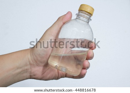 hand hold the bottle