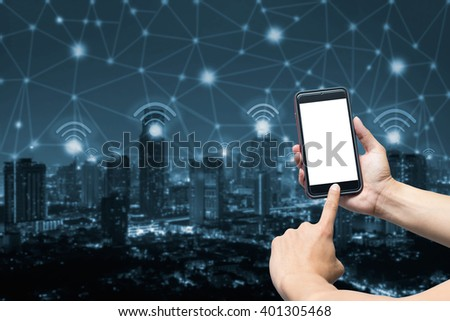 hand holdind smart phone and wifi icon and blue tone city scape and network connection concept - stock photo