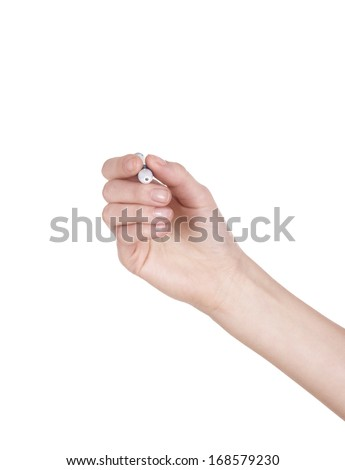Hand holding a black marker isolated on white with copy space. - stock photo