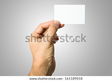 Hand holding a blank business card - stock photo