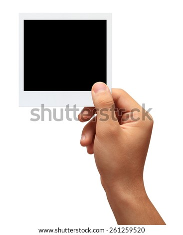 Hand holding a blank photo in front of white background.Studio shot isolation on white.With clipping path - stock photo