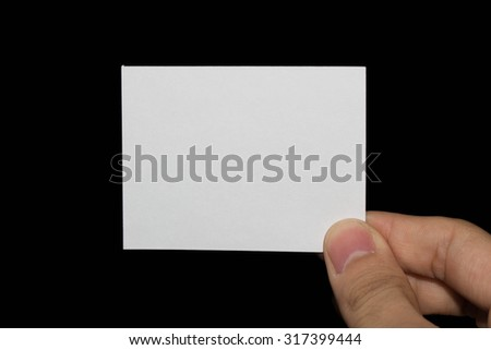 Hand holding a blank piece of paper with gray black