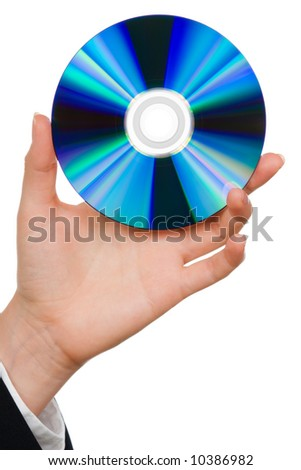 Hand holding a blue computer disk over white - stock photo