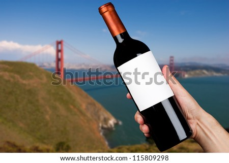 Hand holding a bottle of wine in San Francisco - stock photo