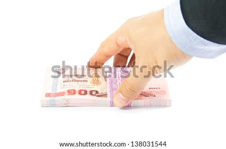 Hand holding a bulk of 100 baht Thailand banknotes