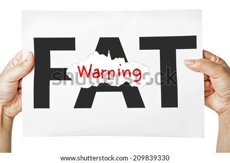 Hand holding a burning paper has FAT text in a middle and see Warning text behind. Fat burn, Work out concept. - stock photo