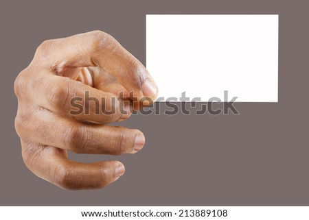 Hand holding a business card over gray background - stock photo