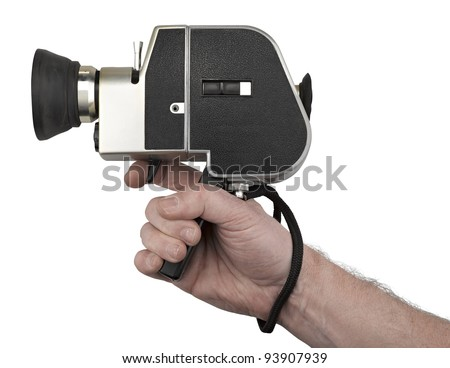 Hand holding a camera super 8 isolated on white - stock photo