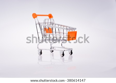 Hand holding a Cart on a white background