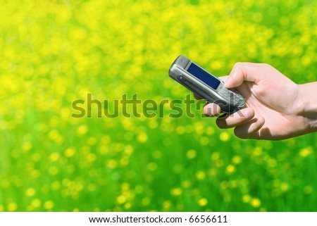 Hand holding a cell phone. - stock photo