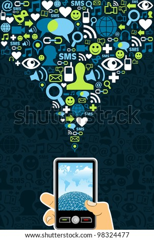 Hand holding a cell phone under social media icons on blue background
