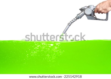 Hand holding a classic fuel nozzle pumping a gasoline fuel green liquid in a tank of oil Industry isolated on white background with clipping path - stock photo
