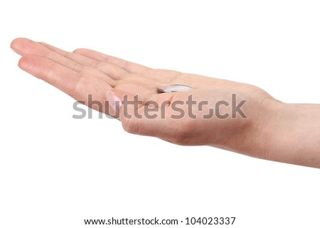 hand holding a coin  on white background
