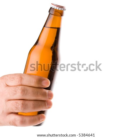 Hand holding a cold beer isolated on white