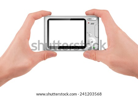 Hand holding a compact digital camera with empty LCD screen (taking pictures) isolated on white - stock photo