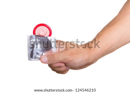 Hand holding a condom in package, isolated on white background - stock photo