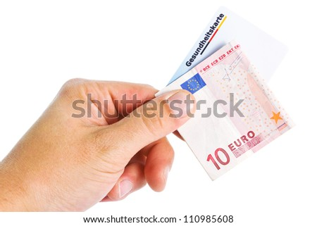 Hand holding a euro banknote and an electronic health card over a white background
