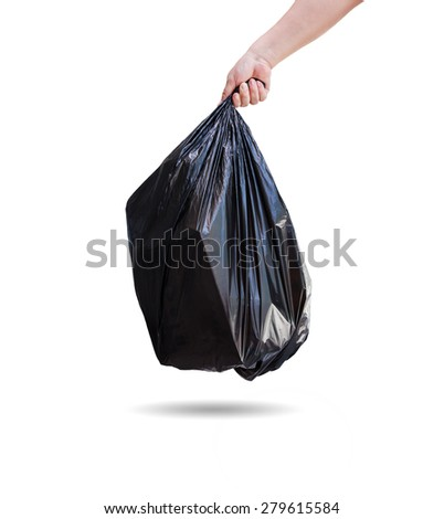 Hand holding a garbage bag on white background. - stock photo