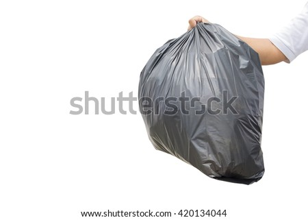 Hand holding a garbage bag on white background - stock photo