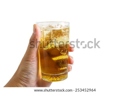 Hand holding a glass of beer isolated on white background. - stock photo