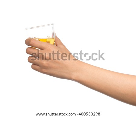 hand holding a Glass of brandy isolated on white background - stock photo
