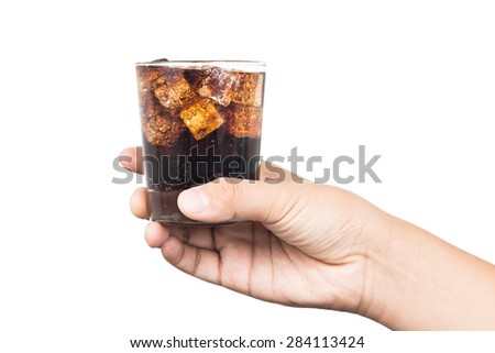 Hand holding a glass of ice filled cold and fizzy cola drink - stock photo