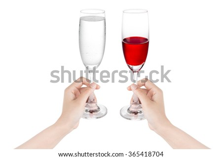 Hand holding a glass of wine cheers. - stock photo
